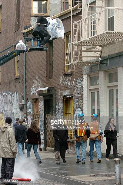 With a camera looming above actor Robert De Niro plays a street scene while filming a commercial for the third annual Tribeca Film Festival and the...