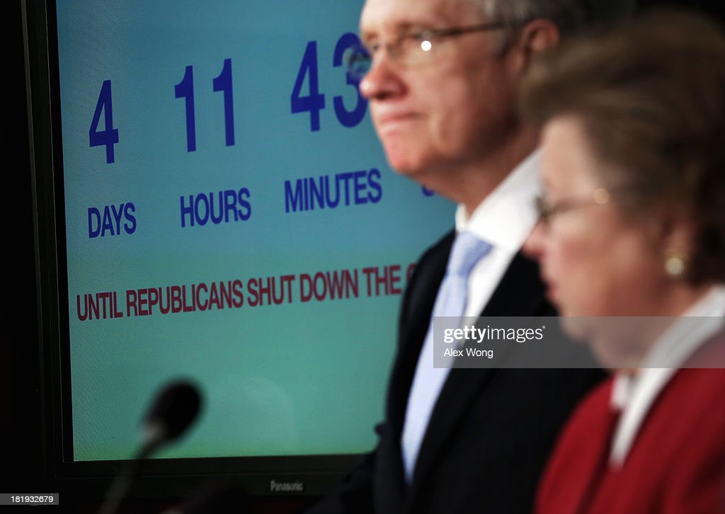 With a countdown timer for a possible governoment shutdown is seen in the background, U.S. Sen. <a gi-track='captionPersonalityLinkClicked' href=/galleries/search?phrase=Barbara+Mikulski&family=editorial&specificpeople=226768 ng-click='$event.stopPropagation()'>Barbara Mikulski</a> (D-MD) (R) and Senate Majority Leader Sen. <a gi-track='captionPersonalityLinkClicked' href=/galleries/search?phrase=Harry+Reid+-+Politician&family=editorial&specificpeople=203136 ng-click='$event.stopPropagation()'>Harry Reid</a> (D-NV) (L) attend a news conference September 26, 2013 on Capitol Hill in Washington, DC. The Democratic senators held a news conference to call on the House Republicans not to shutdown the government.