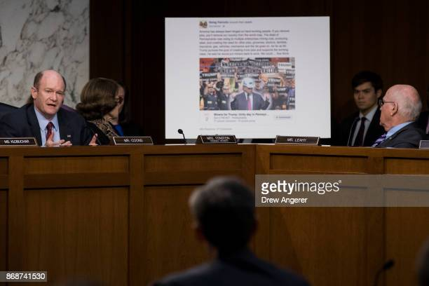 With a Facebook event page featuring a 'Miners For Trump' rally created by Russian operatives displayed behind him Sen Chris Coons questions...