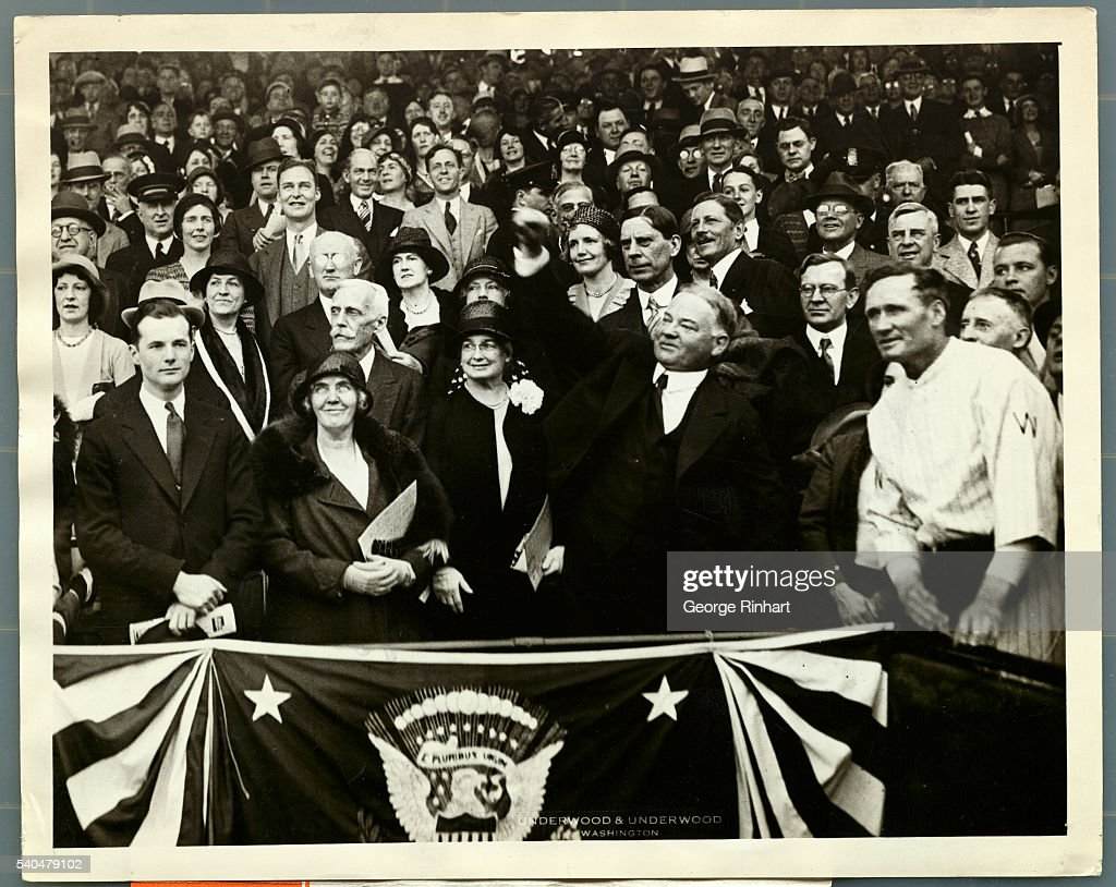 With a mighty heave which sent the ball flying far out into the middle of the diamond President Herbert Hoover officially opened the American League...
