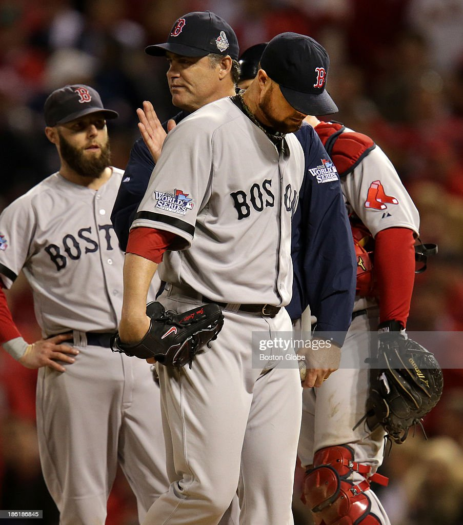 With a pat on the back from manager John Farrell, Red Sox pitcher Jon Lester leaves the game in the eighth inning. The St. Louis Cardinals host the Boston Red Sox at Busch Stadium for Game Five of the 2013 Major League Baseball World Series, Oct. 28, 2013.