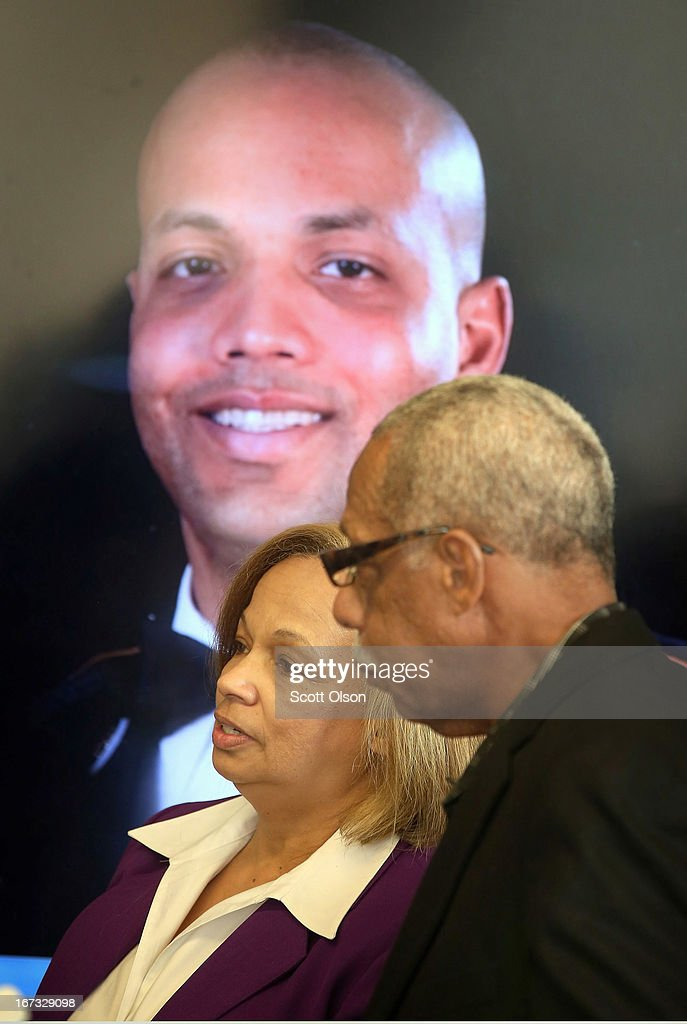 With a picture of their son behind them, retired Chicago police officer Thomas Wortham III and his wife Carolyn Wortham speak to reporters at a press conference where it was announced that a lawsuit has been filed by the Brady Center to Prevent Gun Violence on behalf of the Wortham family against Ed's Pawn Shop and Salvage Yard in Byhalia, Mississippi on April 24, 2013 in Chicago, Illinois. The suit claims that Wortham's son, Chicago Police officer and Iraq War veteran Thomas Wortham IV, was killed by a gun wrongfully sold to a straw purchaser at the pawn shop. Wortham IV was killed outside his parents' home on May 19, 2010 when 4 reported gang members tried to rob him of his motorcycle.