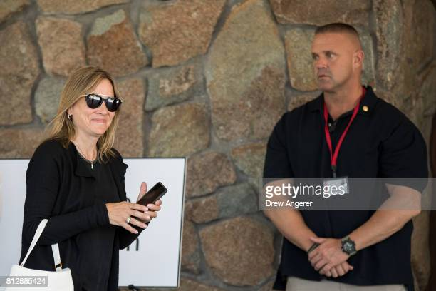 With a security guard looking on Mary Barra chief executive officer of General Motors arrives on the first day of the annual Allen Company Sun Valley...