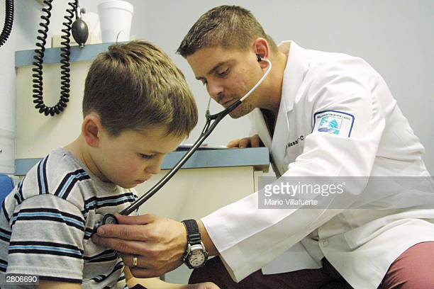 With a temperature of 1038 Asa Moore of Vivian Louisiana is examined by John Messier a physician's assistant at the North Caddo Surgical and Medical...