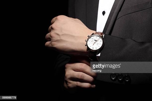 With a wrist watch