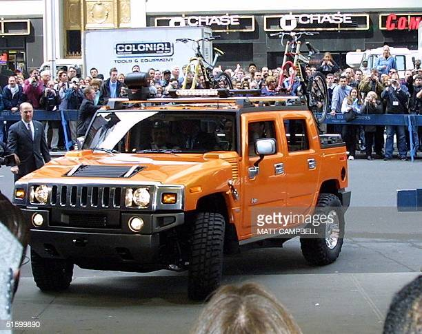 With actor Arnold Schwartzenegger at the wheel General Motor's new Hummer H2 SUT pulls onto the sidewalk in front of ABC Studios in Times Square in...