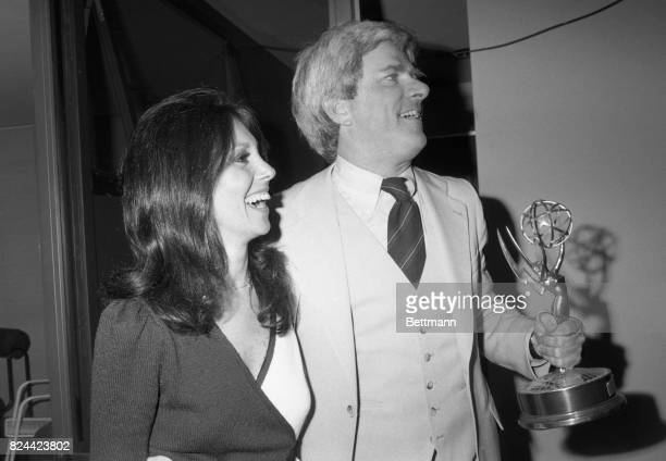 With actress Marlo Thomas at his side Phil Donahue holds an Emmy he received in New York May 17 as the National Academy of Television Arts and...