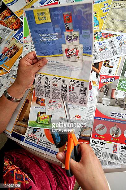 LifestyleUSeconomyconsumer A woman cuts coupons from the advertising section of the Sunday newspaper September 13 2011 in Washington DC The humble...