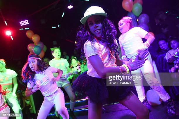 LIFESTYLE Children dance during an electronic dance music party at a night club in New York on October 26 2014 The music's thumping the dance floor's...