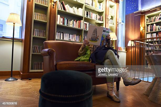 USFranceLiteratureCulture A woman reads a comic book at the Albertine a French Bookstore and library at the French Embassy on Fifth Avenue in New...