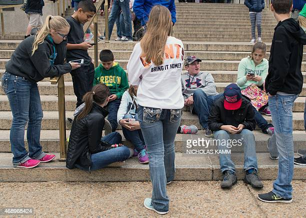 USITInternetphonetechnologyteenagers A group of teens check their smartphones outside the Natural History Museum in Washington on April 8 2015 A Pew...