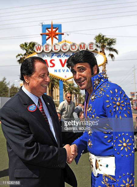 USFrancePoliticsElections ==FrancoAmerican Victor Chaltiel speaks with an Elvis Presley lookalike in Las Vegas Nevada on March 24 2011 as he runs in...