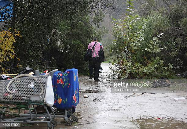 USPovertyHomelessTechnology A man who declined to give his name walks with belongings at the Silicon Valley homeless encampment known as 'The Jungle'...