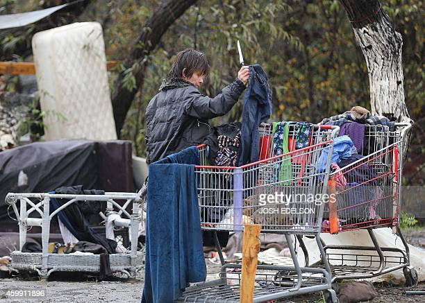 USPovertyHomelessTechnology Wielding a newly found knife Lilly Mei sifts through a shopping cart at the Silicon Valley homeless encampment known as...