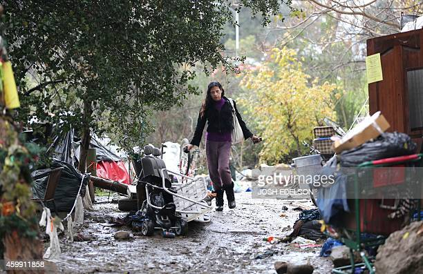 USPovertyHomelessTechnology An unidentified person walks along a muddy path at the Silicon Valley homeless encampment known as 'The Jungle' on...
