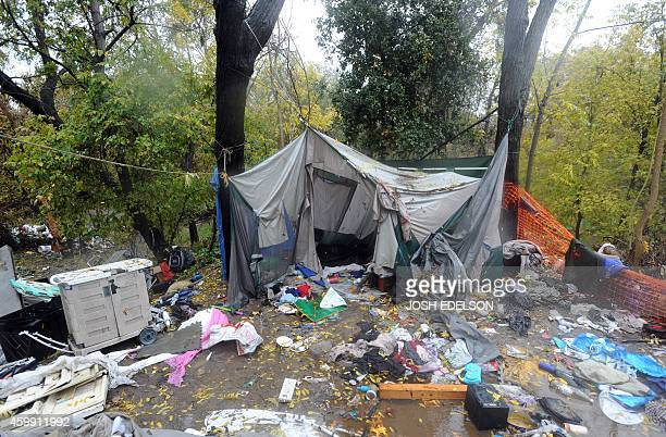 USPovertyHomelessTechnology Debris and trash is scattered around an empty tent at the Silicon Valley homeless encampment known as 'The Jungle' on...