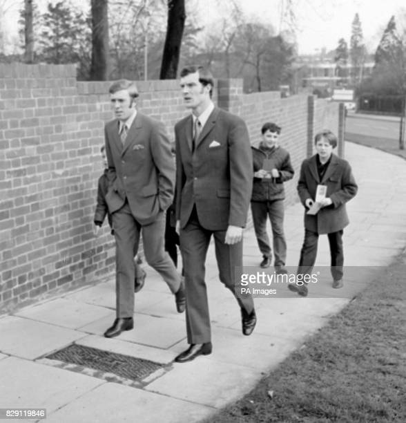 With books at the ready young autograph hunters hopefully trail Leeds United players Mick Jones and Paul Madeley as they stroll at their Hendon hotel...