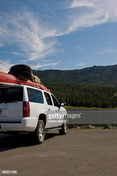 SUV with camping gear on top