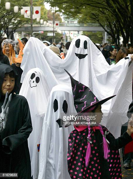 With costumes of Ghosts and witches participants march in the Halloween parade at the Omotesando district in Tokyo 31 October 2004 Thousands of...