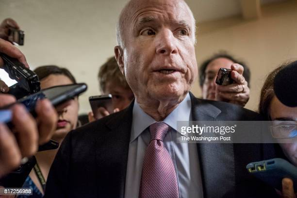 WASHINGTON DC With crowds of journalists asking questions about President Donald Trump and former FBI Director James Comey Senator John McCain rushes...