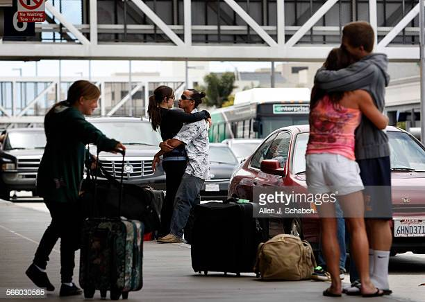 With dad Ray Holley packing bags and sister Christi Holly left watching Ray Holley right of Orange hugs his mom Julie Holley goodbye as he heads to...