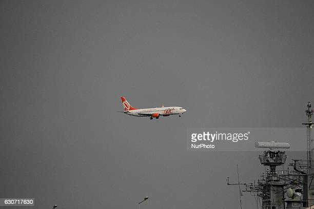 With dark clouds Gol Airlines plane arrives to land at Santos Dumont Airport in Rio de Janeiro Brazil on December 30 2016 As is typical in summer the...