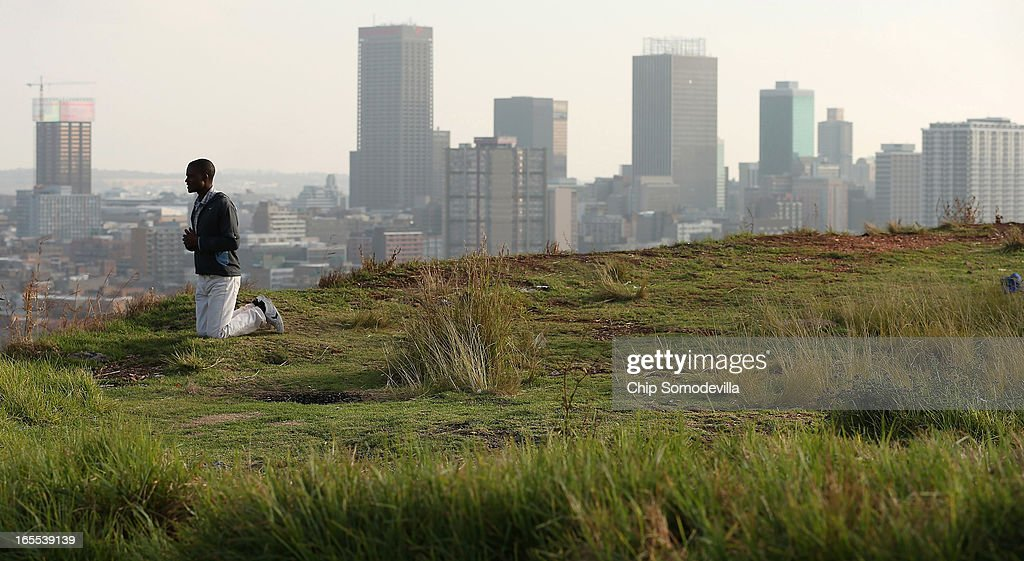 With downtown Johannesburg rising in the background, a member of the Twelve Apostles Church of Christ prays on a hill in the Yeoville neighborhood April 4, 2013 in Johannesburg, South Africa. Members of the church, many of them immigrants from Zimbabwe, gather to pray in the open on the hill overlooking downtown Johannesburg because they say the Bible tells the faithful to go to the mountaintop to pray. According to government officials, Noble Peace Prize laureate and former South African President Nelson Mandela, 94, contiunes to recover from pneumonia after spending more than a week in the hospital, his third time since December.