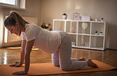 With exercises, birth will be easy. Pregnant woman working exercise.