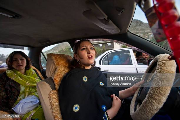 With face hair and arms in full view actress Trena Amiri chauffeurs a friend around Kabul on a Friday She blasts her favorite songs off a cassette...