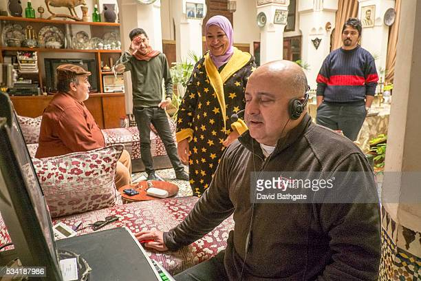 With family members looking on visiting Khalid Drissi talks via Skype from his brother's upperclass home in Medina Fes with Moroccan relatives living...
