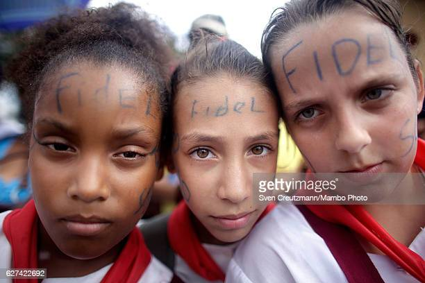 With 'Fidel' written on their faces schhool children wait for the remains of former Cuban President Fidel Castro to pass by on their fourday journey...