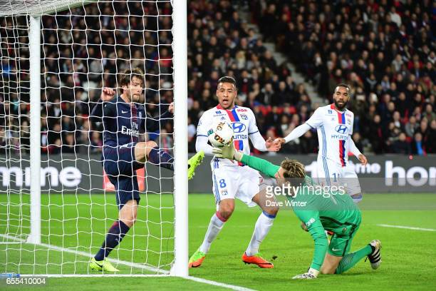 With goalkeeper Kevin Trapp of PSG beaten Sherrer Maxwell of PSG clears off the line under pressure from Corentin Tolisso of Lyon during the French...