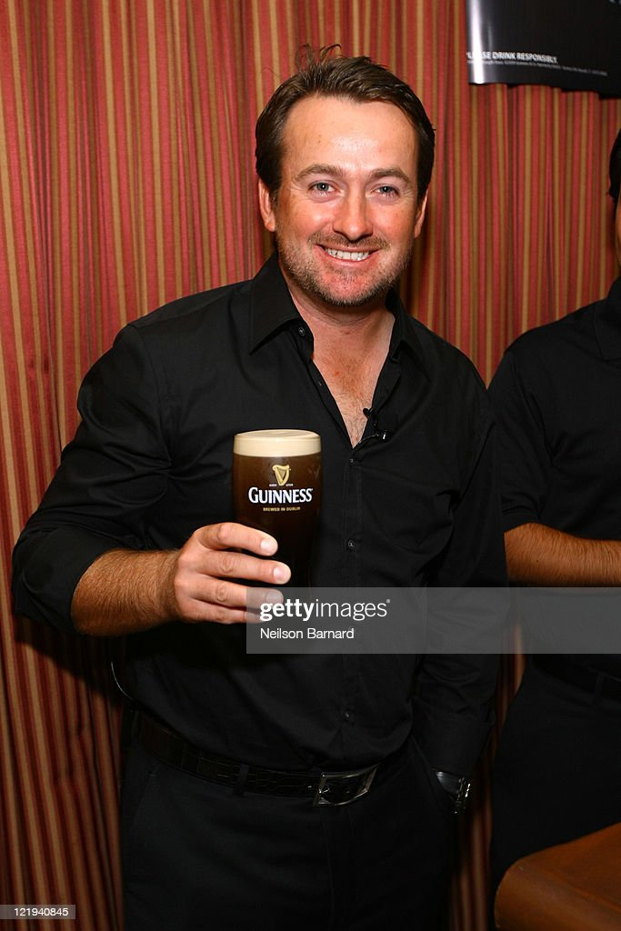 With Guinness in hand, pro golfer and 2010 US Open Champion <a gi-track='captionPersonalityLinkClicked' href=/galleries/search?phrase=Graeme+McDowell+-+Golfer&family=editorial&specificpeople=196520 ng-click='$event.stopPropagation()'>Graeme McDowell</a> hosts the G-MAC Foundation event on August 23, 2011 in New York City.