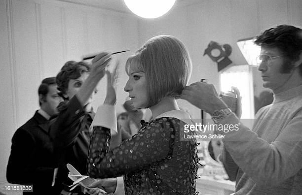 With help from her hairdresser Fredrick Glaser American singer and actress Barbra Streisand prepares for attending the Academy Awards Los Angeles...