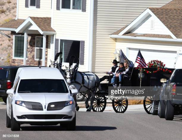 With her children on top a horse drawn hurst carries the casket of Heather Lorraine Alvarado through her neighborhood after her funeral services on...