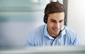 Shot of a handsome young man working in a call center