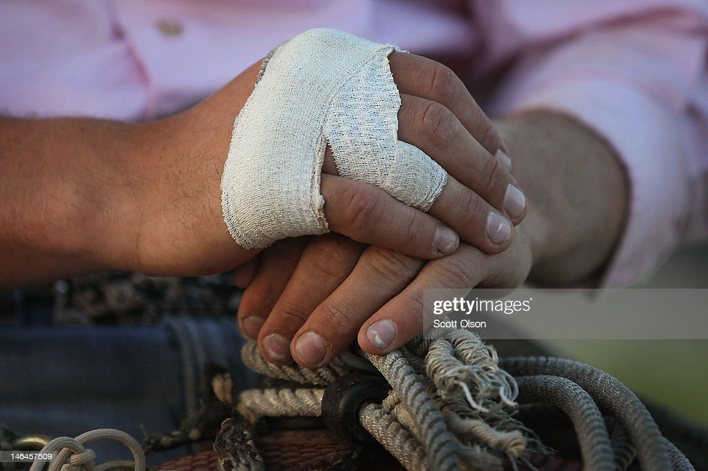 With his hand wrapped from an earlier injury Whalen Pickerill waits to compete in his next event at the Illinois High School Rodeo Association State Finals on June 16, 2012 in Altamont, Illinois. Winners in the competition will go on to compete in the high school national championships July 15-21 in Rock Springs, Wyoming.