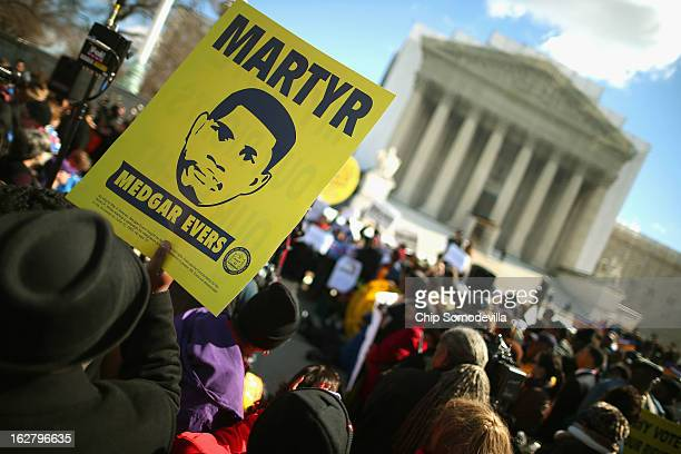 With images of murdered Mississippi civil rights worker Medgar Evers demonstrators rally in front of the US Supreme Court February 27 2013 in...