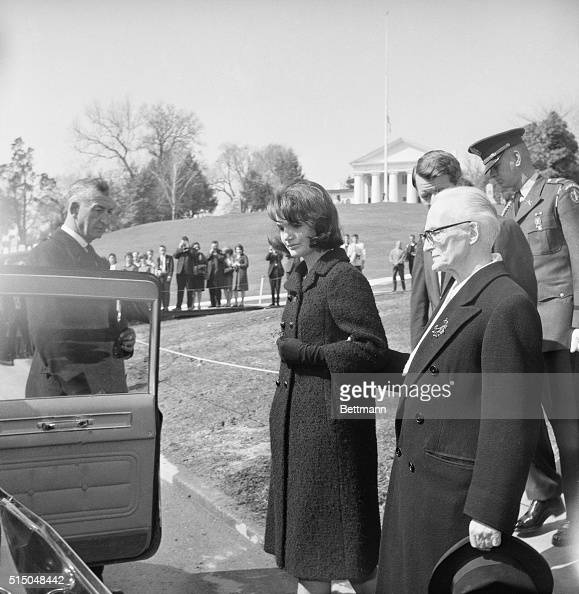 With Irish Ambassador Thomas J Kiernan and Attorney General Robert F Kennedy Mrs John F Kennedy walks from the grave of the late President today Mrs...