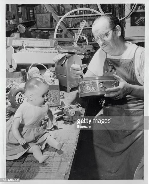 With loving care Elliott L Hayden of Pasadena California works on a jackinthebox repairing a toy that he will give away next Christmas The disabled...