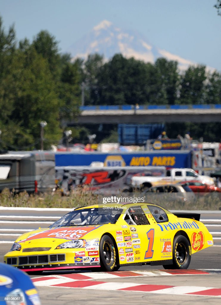 With Mt. Hood looming in the background, Jim Inglebright winds his way through the Chicane during the NASCAR Camping World Series West BI-MART Salute to the Troops 125 at Portland International Raceway on July 19, 2009 in Portland, Oregon. Inglebright won the race.