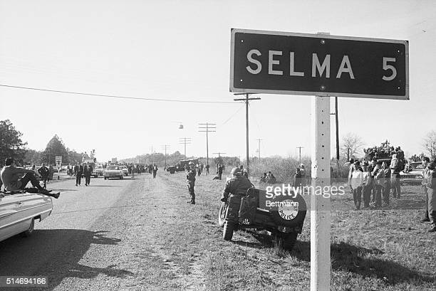 With National Guardsmen on the roadside civil rights marchers begin the 50 mile march to Montgomery Alabama to protest race discrimination in voter...
