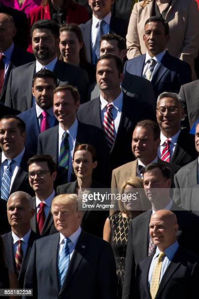 With National Security Advisor HR McMaster standing next to him President Donald Trump poses for a group photo with members of the White House...