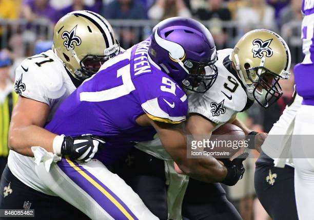 With New Orleans Saints offensive tackle Ryan Ramczyk all over his back Minnesota Vikings defensive end Everson Griffen sacks New Orleans Saints...