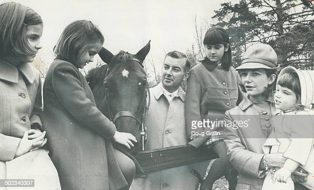 With one of the Gayford horses is rider Tom Gayford centre with his family The older girls are Margaret 9 Mary 8 and Jannie 7 Mrs Gayford holds baby...