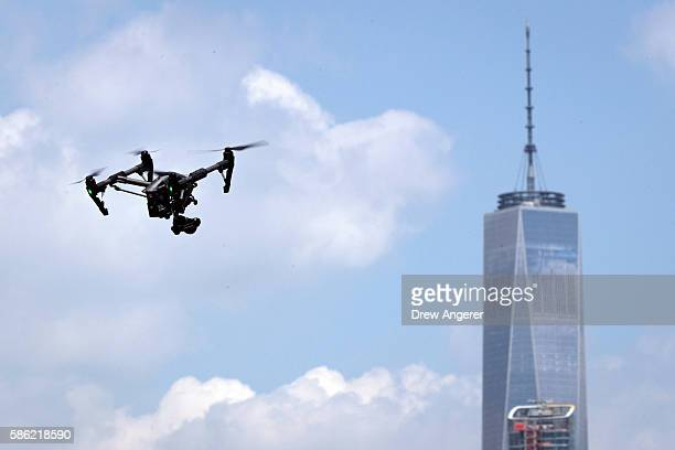 With One World Trade Center behind it a drone flies during practice day at the National Drone Racing Championships on Governors Island August 5 2016...