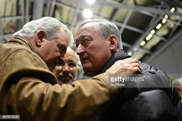 With PA Gov Tom Wolf looking on in the back Rep Bob Brady talks to Mayor Jim Kenney at a Muslim Ban Protest at Philadelphia International Airport on...