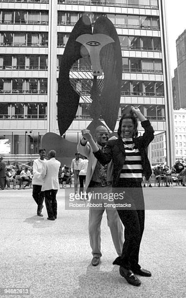 With Pablo Picasso's sculpture in the background Chicagoans dance away the warm summer days in downtown's Daley Plaza Chicago IL 2001
