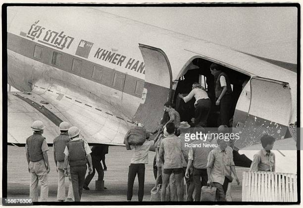 With Pochentong airport virtually under siege every available plane is put into use by Cambodians desperate to escape their country for Saigon or...