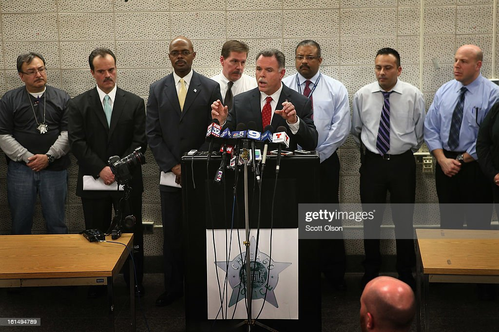 With police officers who solved the case behind him, Chicago Police Superintendant <a gi-track='captionPersonalityLinkClicked' href=/galleries/search?phrase=Garry+McCarthy&family=editorial&specificpeople=6268988 ng-click='$event.stopPropagation()'>Garry McCarthy</a> announces arrests have been made in the murder of 15-year-old Hadiya Pendleton during a press conference at Area Central on February 11, 2013 in Chicago, Illinois. Suspected gang members Micheail Ward and Kenneth Williams have been charged in the murder. McCarthy said the two thought they were shooting at rival gang members in retaliation for a July 2012 incident when Williams was shot. Hadiya's murder was the 44th murder in Chicago in January.